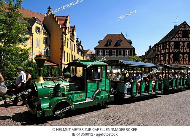 Tourists in a tourist train for sightseeing tours, Colmar, Alsace, France, Europe