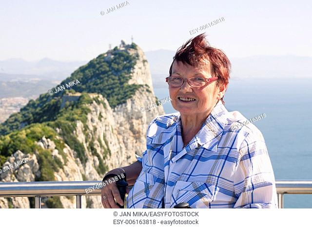 Portrait of happy senior woman tourist at the Rock of Gibraltar