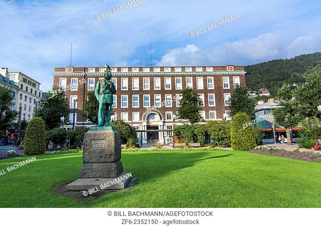 Bergen Norway downtown statue of composer Edward Grieg with Rikstelegraf and Rikstelefon building in background bronze memorial favorite composer in Norway