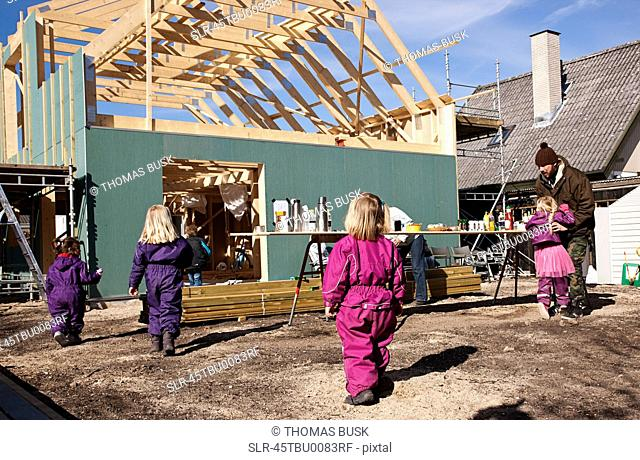 Children walking on construction site