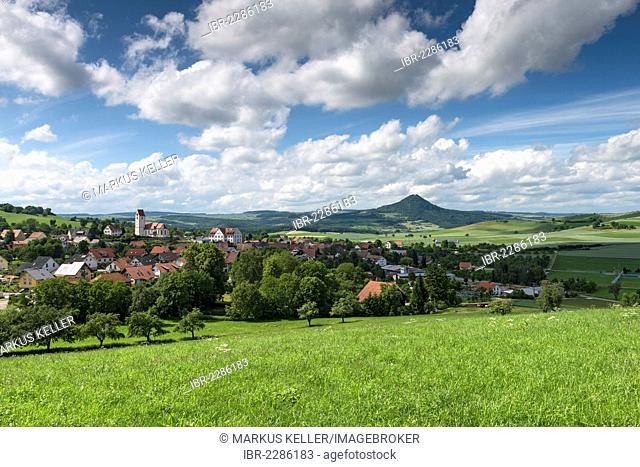 View across a meadow, Hegau landscape with the village of Weiterdingen, Hohenhewen volcano at the back, Baden-Wuerttemberg, Germany, Europe