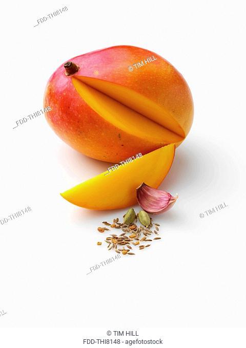 Honey mango with garlic cardomon fennel fenugreek cumin