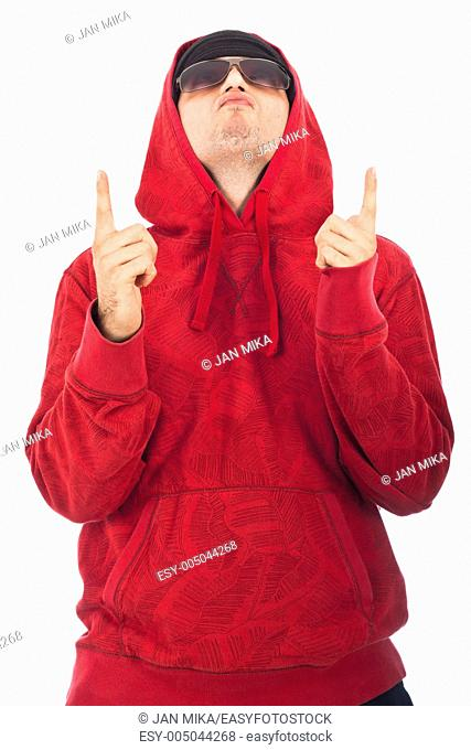 Hip Hop dancer in red hoody looking and pointing up Isolated on white background