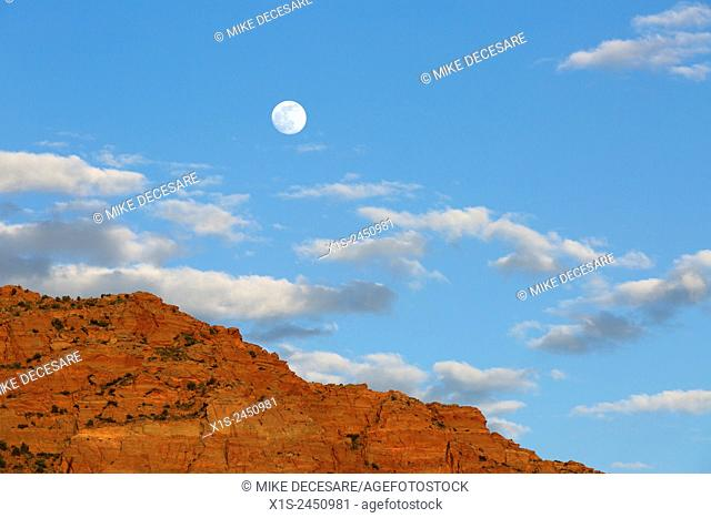 Full moon rises over a wilderness landscape in the American Southwest