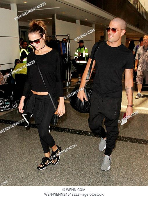 Max George and his girlfriend Carrie Baker depart from Los Angeles International Airport (LAX) Featuring: Max George, Carrie Baker Where: Los Angeles
