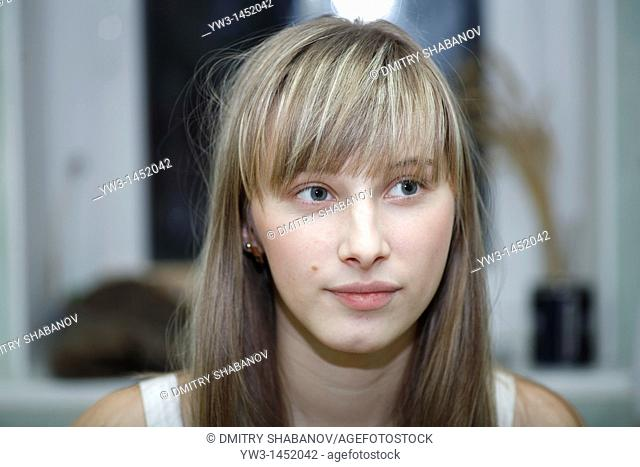 Headshot of a 24 year old blonde Caucasian woman indoors