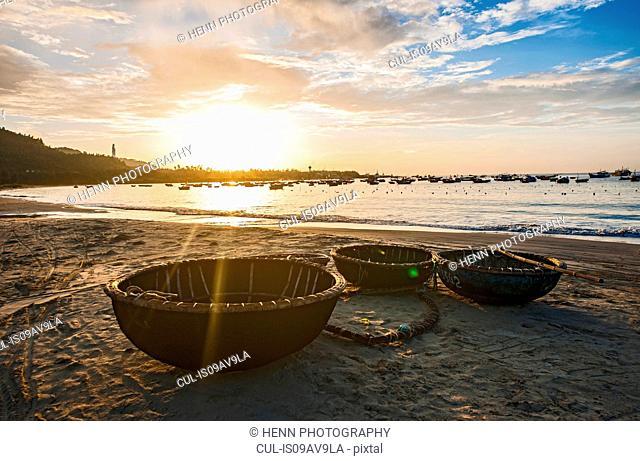 Traditional basket boats on beach at sunset, Da Nang, Vietnam