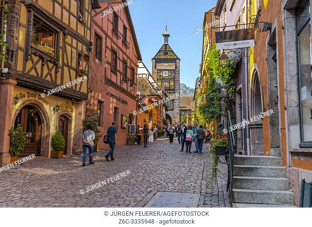 street in the old town of Riquewihr, Alsace, France, typical framework and town wall with tower