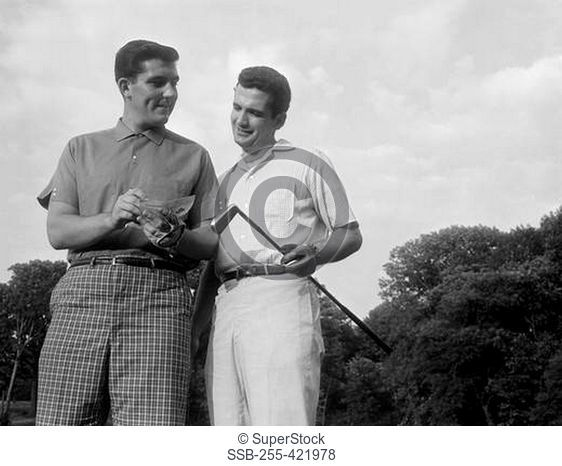 Pair of male golfers checking score
