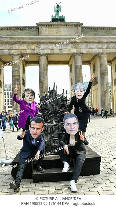 11 May 2019, Berlin: Activists with masks of the European politicians Angela Merkel (l-r, Chancellor of Germany), Emmanuel Macron (President of France)