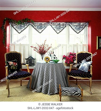LIVING ROOMS: Red walls. Black and white checkered cloth, shutters, toile triangle valance