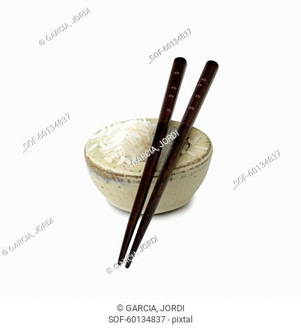 Cut out bowl of white rice and chopsticks