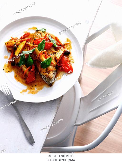 Fish tagine with vegetables and garnish