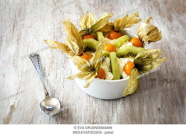 Wholefood dish with kiwi, physalis and cream