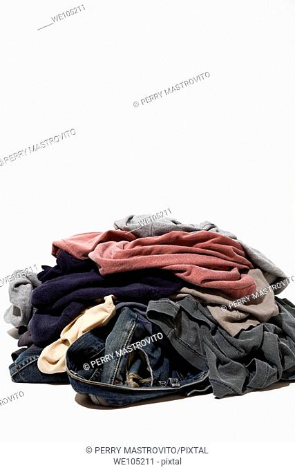 Pile of dirty clothes on a white background, Studio Composition