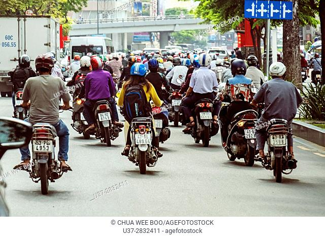 Street setting, moped riders on a street at Saigon, Hoh Chi Minh City, Vietnam, Asia