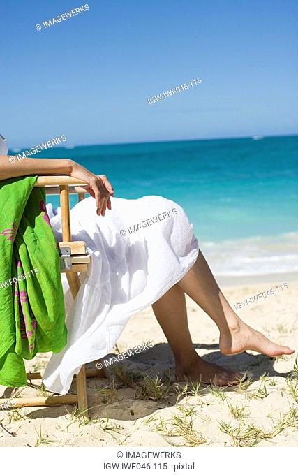 Low section of a woman sitting on chair