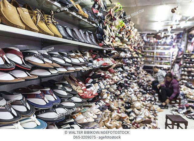 Cambodia, Battambang, Psar Nath Market, shoe vendor