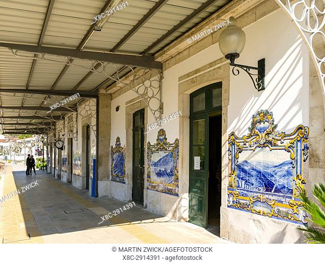 Pinhao railway station with typical blue Azulejos, the landmark of the village. The valley of river Douro. It is the wine growing area Alto Douro and listed as...