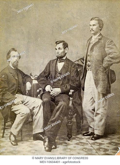 Lincoln & his secretaries, Nicolay & Hay. Photo shows President Abraham Lincoln seated between his private secretaries John G