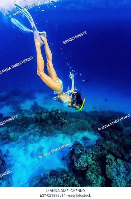 Woman diving to the sea bottom