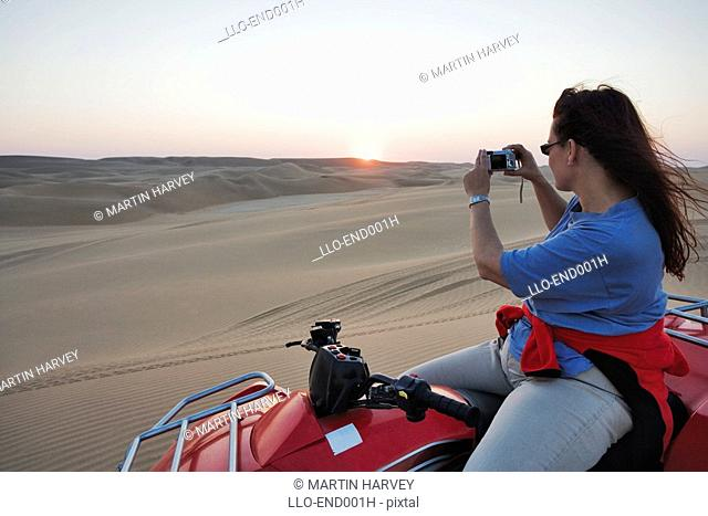 Women on Quadbike Taking Picture  Sossusvlei, Namibia, Southern Africa