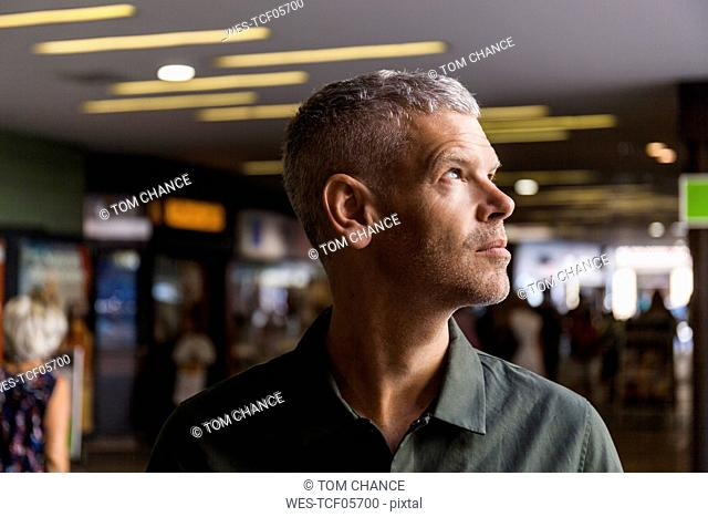 Portrait of a mature man in the city looking sideways