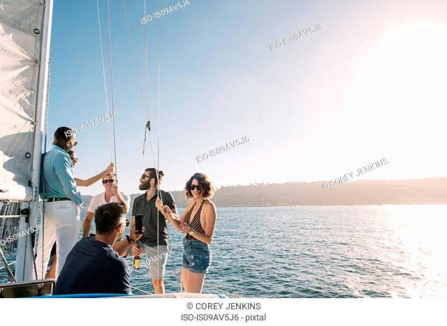 Friends chatting on sailboat, San Diego Bay, California, USA