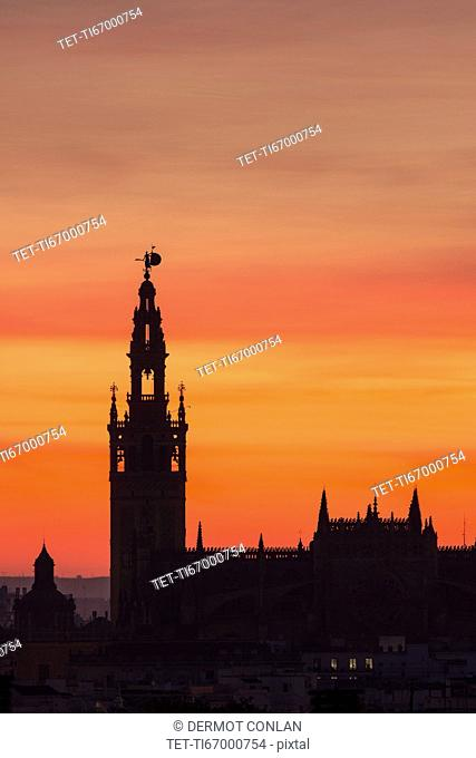 Spain, Seville, Silhouette of Giralda and Cathedral of Sevilla at sunset