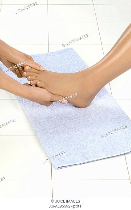 Close up of woman receiving pedicure