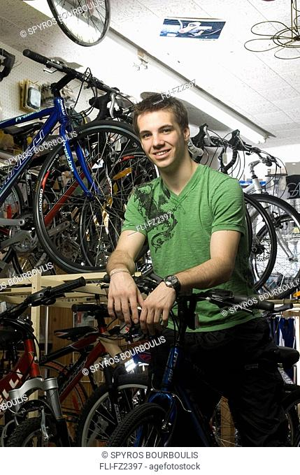 Cyclist in bicycle shop, Laval, Quebec
