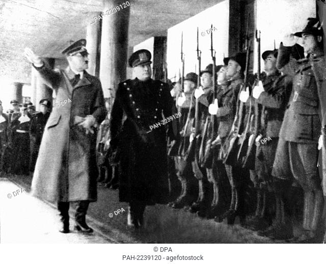 Adolf Hitler (l) and Italian Prime Minister and Duce Benito Mussolini (r) walking down an honor guard during their meeting at the Brenner Pass on 18 March 1940