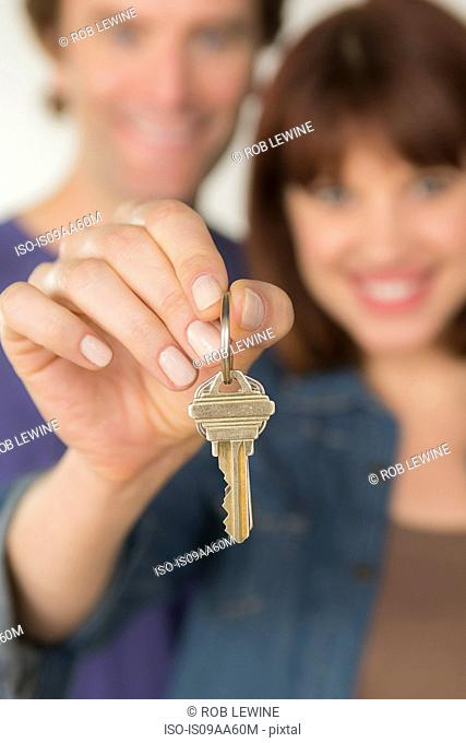 Couple holding new door key