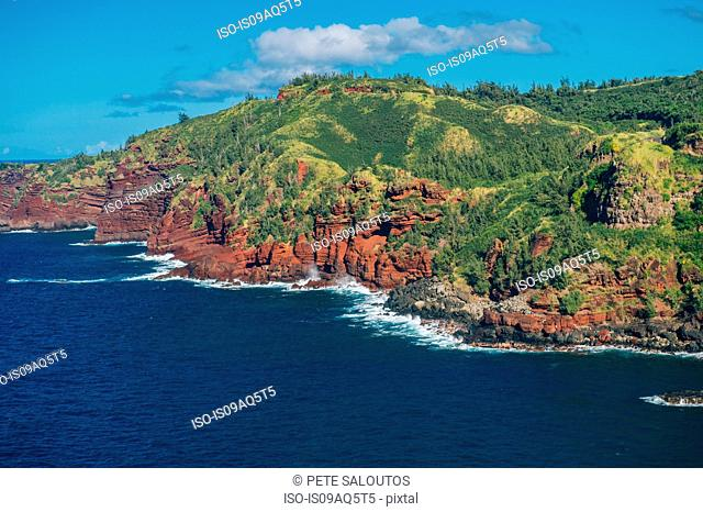 View of sea and red cliffs, North Shore, Maui, Hawaii