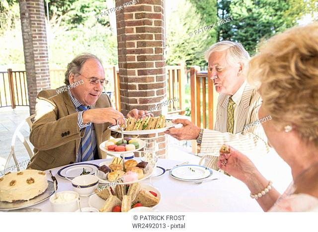 Senior people having tea on the balcony