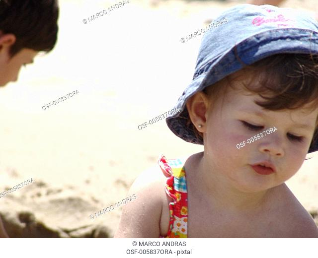 little girl playing on the beach sand shore