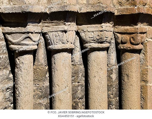 Columns and capitals on the main front of the Romanesque collegiate church of Santa Maria (12th century), Ainsa. Sobrarbe, Huesca province, Aragon, Spain