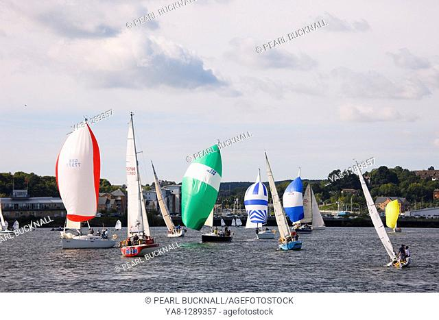 Cardiff Bay Bae Caerdydd, Glamorgan, South Wales, UK, Europe  Yachts with colourful spinnakers in regatta