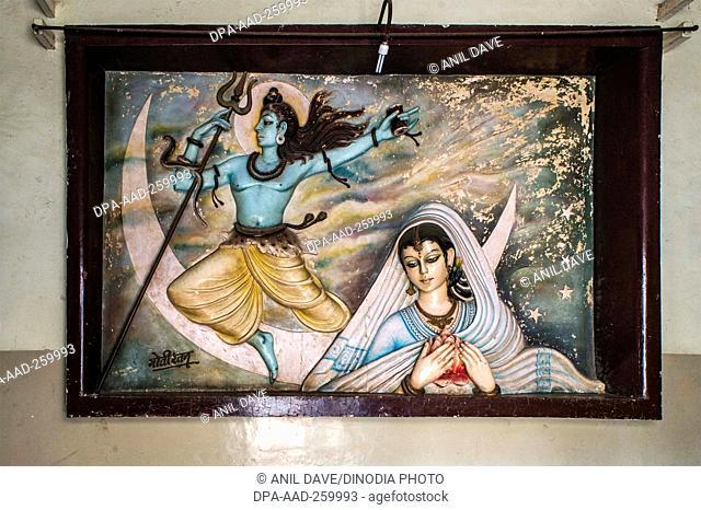 relief painting of Shiva and devotee in kalpana cinema, kolhapur, Maharashtra, India, Asia