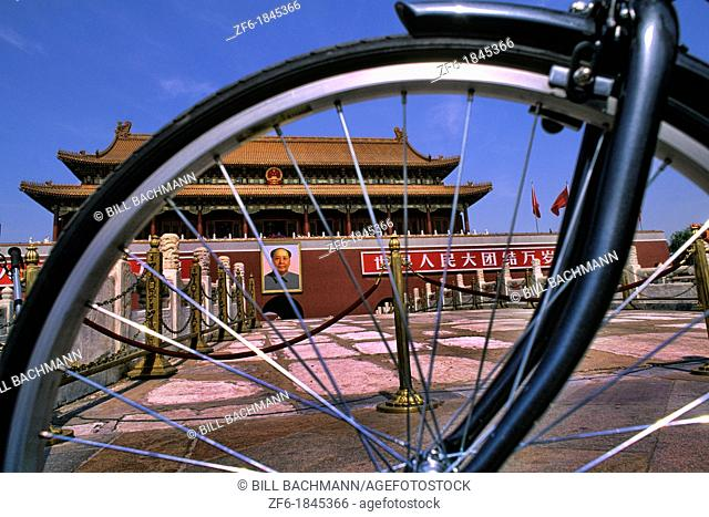 Graphic image of bike and Mao portrait at Heavenly Gate in Beijing China