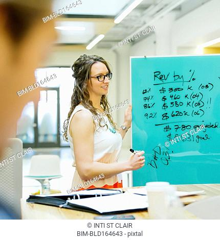 Caucasian businesswomen talking in office meeting