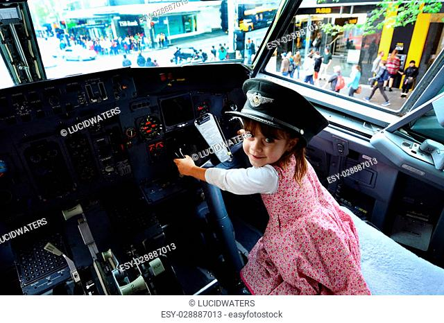 AUCKLAND - OCT 18 2015:Little girl (Talya Ben-Ari age 05) fly a Boeing 737.It's the best-selling jet commercial airliner, with 8