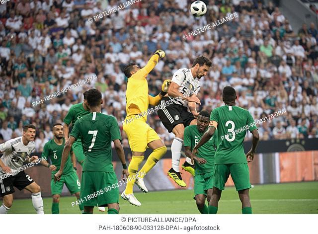 08 June 2018, Germany, Leverkusen: Football international friendly, Germany vs Saudi Arabia at the BayArena. Saudi goalie Abdullah Al-Muaiouf (c) punches the...