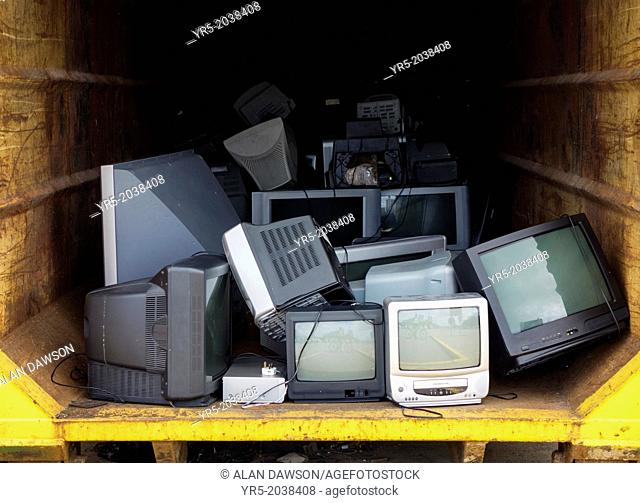 Old Televisions at domestic recycling centre near Billingham, England, United Kingdom