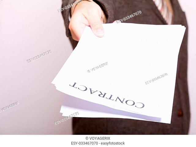 Business concept signing contract. Businessman giving blank empty paper sheet with sign contract and space for text