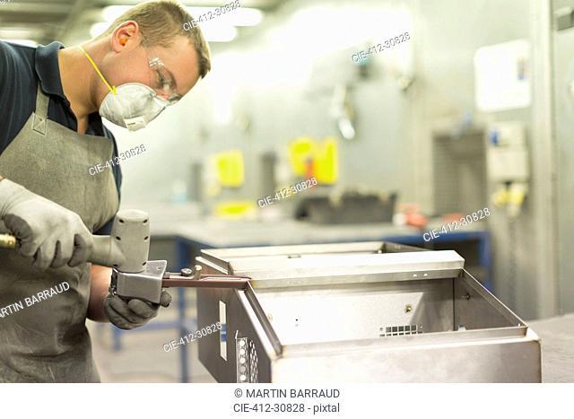 Worker using equipment in steel factory