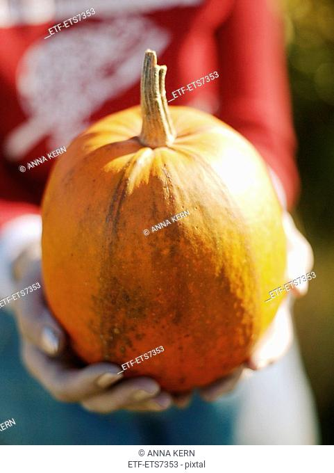 A woman holding a pumpkin Sweden