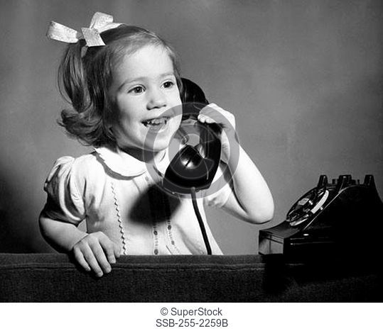 Close-up of a girl talking on the telephone