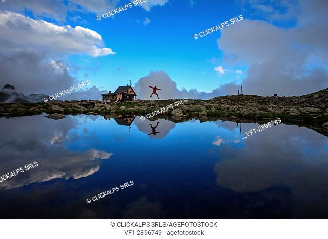 Jump reflection at Benigni hutte, Gerola valley, Orobie alps, Lombardy, Italy