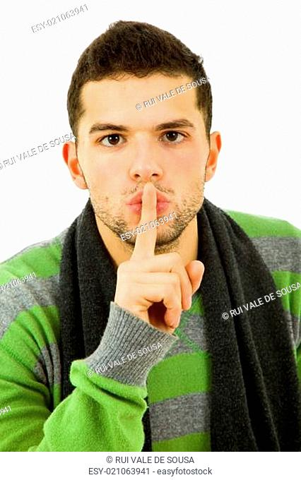 young man showing silence gesture with his finger in the mouth